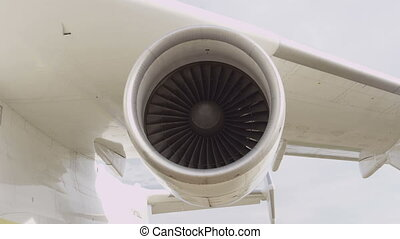 Jet engine of an airplane.