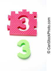 Number three puzzle mats. Focus on the front (small DOF)