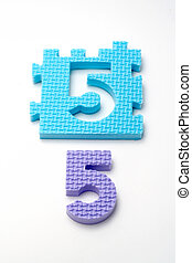 Number five puzzle mats. Focus on the front (small DOF)