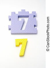 Number seven puzzle mats. Focus on the front (small DOF)