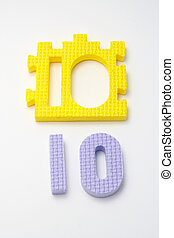 Number ten puzzle mats. Focus on the front (small DOF)