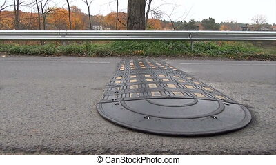 speed bump road man - Closeup of speed bump on rural road....