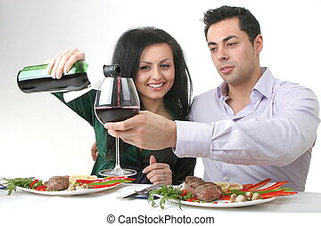 Romantic dinner - Couple having a romantic dinner with a...