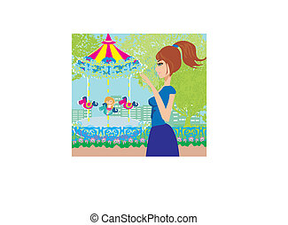 child playing on the carousel