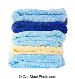 stack  of washed towels  isolated on white background