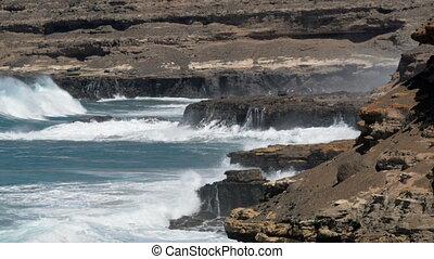 big waves crushing on rough coast
