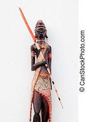 Wooden african figurine doll on white background
