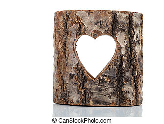heart cut in hollow tree trunk on white background