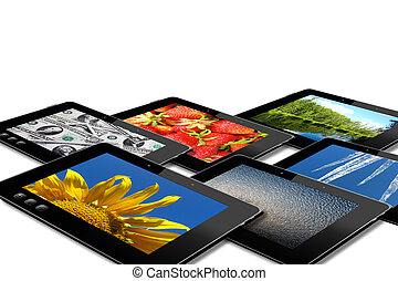 some black tablets with motley pictures isolated on white...