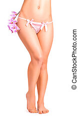 legs with orchid flower on white