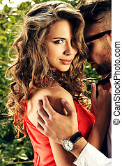 sensuality - Beautiful romantic couple in love standing...
