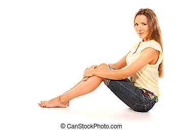 feminine - Portrait of a beautiful young woman sitting on a...