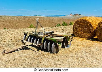 Harrow - Landscape with Harrow and Hay Bales in Tuscany