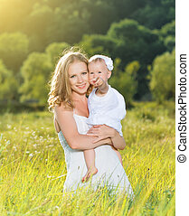 happy family on nature mother and baby daughter - happy...
