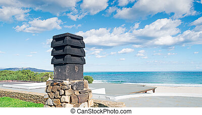 black chimney by the shore