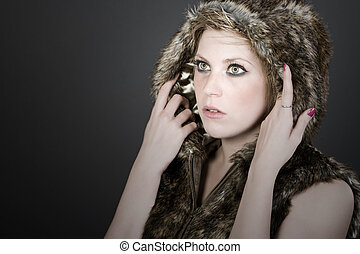 Shot of a Pretty Blonde Girl in Hooded Fur Top