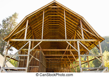 An open wooden hay barn - An old wooden open hay barn shows...