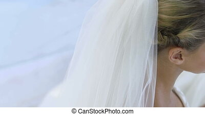 Beautiful bride smiling up at camera on her wedding day