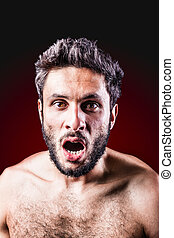 naked and shocked - a very muscular young boxer with red...