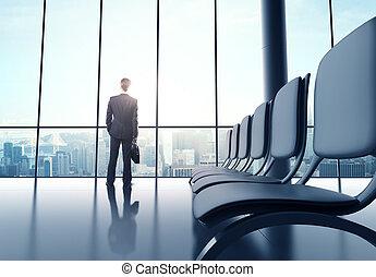 futuristic office - businessman standing in futuristic...