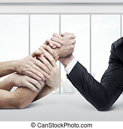 business arm wrestling - arm wrestling: businessman in...
