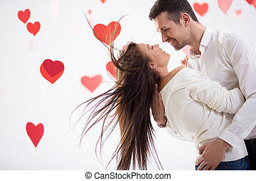Happiness - Smiling couple on a white background