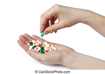 Two woman hands and pill