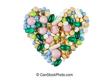 Heart shape made of color pills