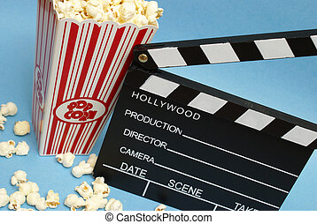 Film Industry - A clean clapboard and popcorn to express the...