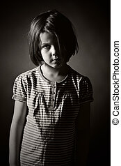 Sad Little Girl - Low Key Black and White Shot of a Sad...