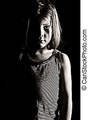 Young Child Looking Depressed - Shot of a Young Child...