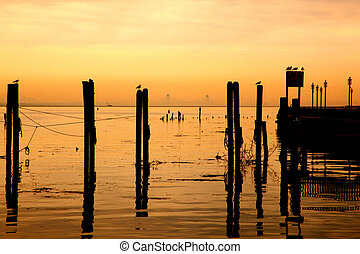 Nautical Silhouette - silhouette of pilings and bridge