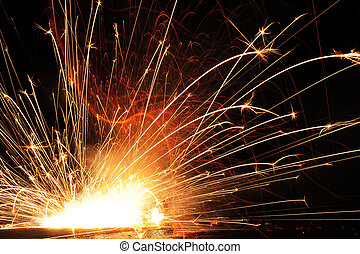 Sparks - Hundreds of sparks dance and shoot into the air on...