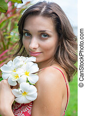 Girl with flower - The young beautifu women rest on tropikal...