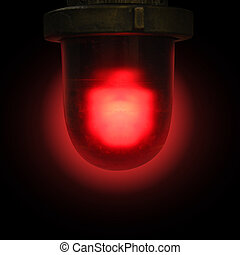 Red Emergency Siren on Black Background - A red flashing...