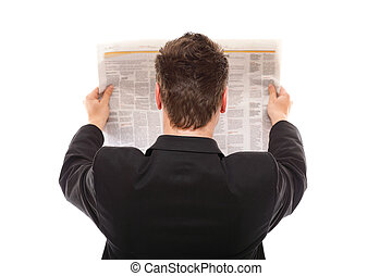 Businessman reading a newspaper isolated - Businessman view...
