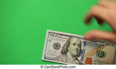 Man counting money on green