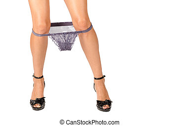 Underwear down - Female legs with underwear pulled down at...