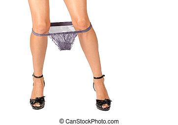 Underwear down - Female legs with underwear pulled down at...