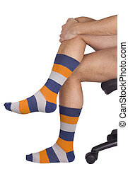 Male legs in colorful socks. Isolated on white background....