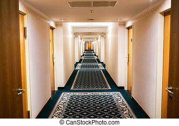 Hotel hallway - Perspective of a hotel hallway with room...