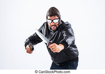 Violent young man holding weapons - Violent young man with...