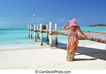 Girl on the wooden jetty. Exuma, Bahamas