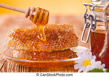 Honey in jar with honeycomb and wooden drizzler - Still life...