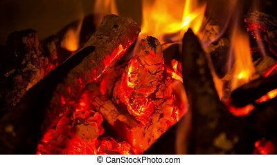 firewood burning in fireplace - The firewood burning in the...