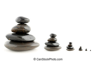 Balanced stones - Stacks of balanced stones with shadow on...