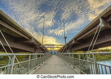 Walkway between Bridges - A cement walkway suspended between...