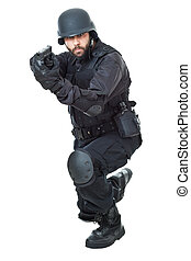 Swat agent - a swat agent wearing a bulletproof vest and...