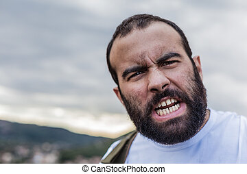 Rage - portrait of a crazy man showing the teeth in anger