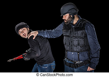 Catching a Thief - a cop wearing the SWAT tactical vest...